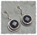 Sterling bezel set onyx faceted coin earring.