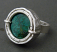Turquoise encased in hammered and etched sterling ring