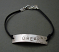 Sterling 'DREAM' bracelet on brown cord bracelet