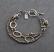 Oxidized sterling and 14kt goldfill multi strand bracelet.