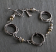 Oxidized sterling coil bracelet with goldfilled accents