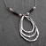 Hammered sterling teardrops with oxidized coils and white pearl necklace