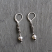 Oxidized sterling coil and white pearl drop earring. Sterling leverback hook.